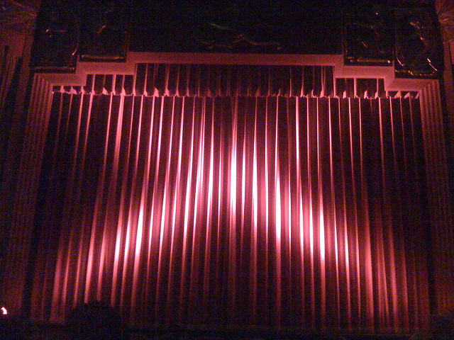 Closed red curtain at the Coolidge Corner Theatre