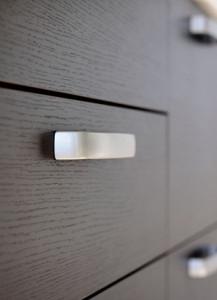 Close up of dark cherry wood dresser drawers