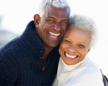 couple hugging and smiling at camera