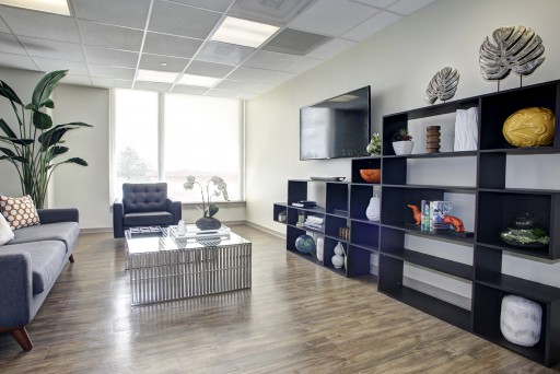 Hodge on 7th Living Room with wood floors, modern furniture and mounted HDTV