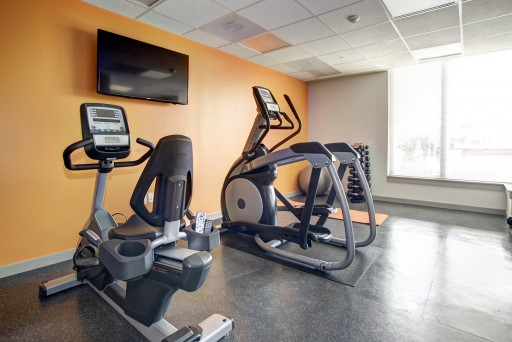 Hodge on 7th apartments fitness center with exercise bike and elliptical machines