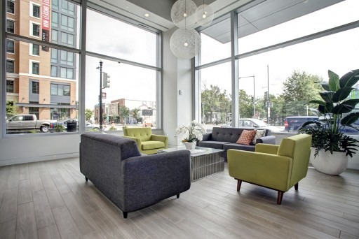 Hodge on 7th resident lounge area with new modern furniture and natural light from windows overlooking street