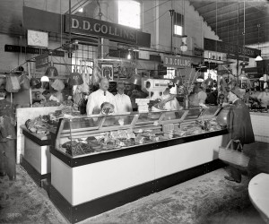 old Black and white photo of butcher counter at Collins Meat Market