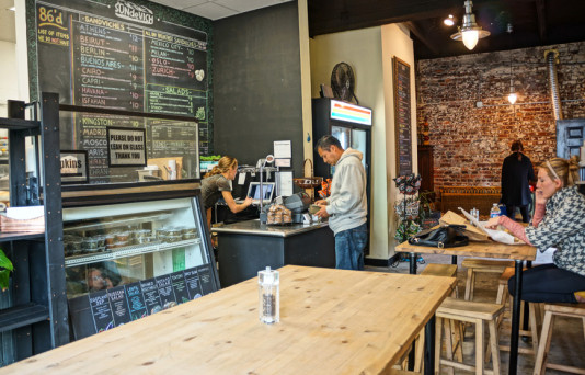 Interior of coffee shop by Hodge on 7th