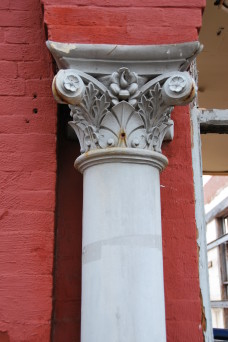 White column outside red building in Shaw neighborhood